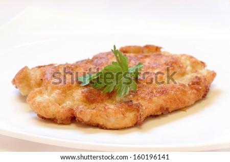 Schnitzel on white plate  - stock photo