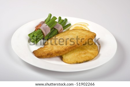 Schnitzel with beans - stock photo