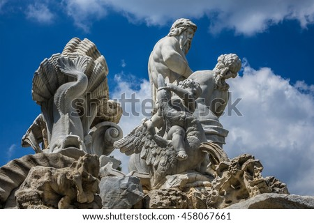 Schoenbrunn palace - former imperial summer residence, built and remodelled during reign of Empress Maria Theresa (1743). Neptune Fountain in Great Parterre of Schoenbrunn public park. Vienna, Austria - stock photo
