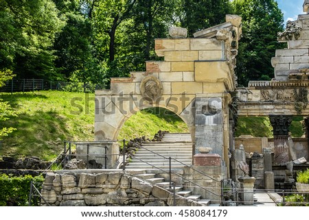 Schoenbrunn palace - former imperial summer residence, built and remodelled during reign of Empress Maria Theresa from 1743. Ensemble artificial Roman ruin (or Ruin of Carthage 1778). Vienna, Austria. - stock photo