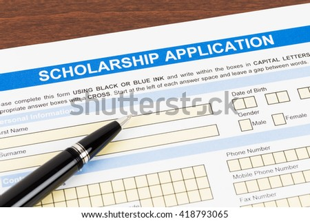 Scholarship application form with pen - stock photo