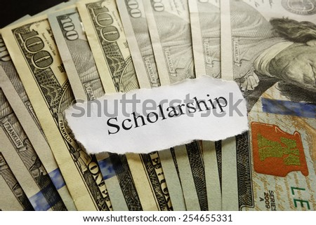 Scholarship paper note on assorted cash                                - stock photo
