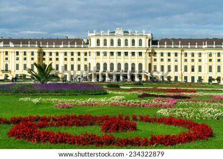 Schonbrunn Palace in the summer with blossoming flower beds, Vienna, Austria - stock photo