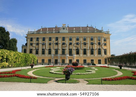 Schonbrunn palace's wing with a park detail. - stock photo
