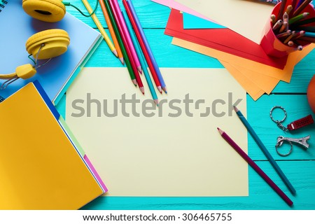 School accessories on blue wooden table - stock photo