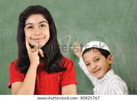 School activities on board, girl and boy in classroom