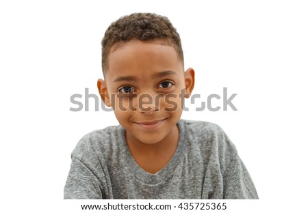 School Age Handsome Boy looking at camera isolated on white background