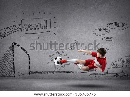 School aged boy on sketched background playing football
