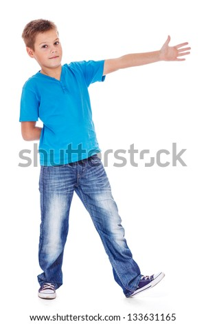 School aged boy showing direction - stock photo