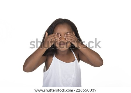 School aged child covering her eyes isolated on white - stock photo
