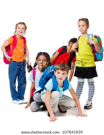 School aged children group with backpacks - stock photo