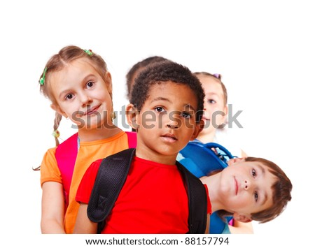 School aged kids with backpacks, isolated - stock photo