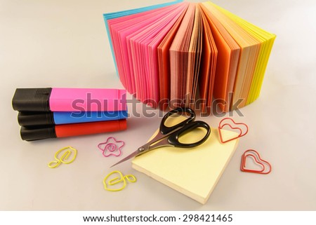 School and office accessories - memo, scissors, paper clips, working for the joy. overlooking writing materials promote the work at the desk. For a positive atmosphere at work  - stock photo