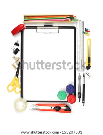 School and office supplies and empty clipboard isolated on white background.