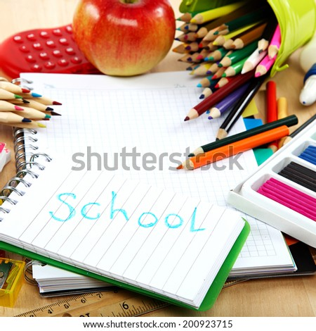 School and office supplies on a wooden table. Back to school. - stock photo