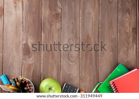 School and office supplies on classroom table. Top view with copy space - stock photo