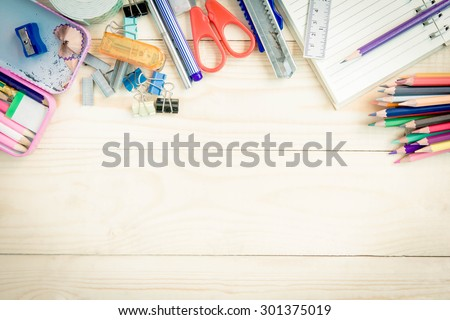 School and office supplies on wood background. - stock photo
