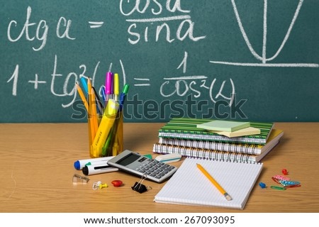 School. Back to school - blackboard with pencil-box and school equipment on table - stock photo