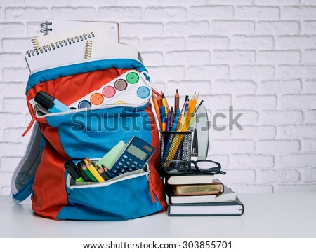 School backpack and school supplies. Time to study - stock photo