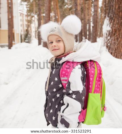 school backpack, winter, schoolgirl , smile - stock photo