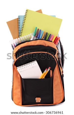 School bag backpack full with supplies and equipment, isolated - stock photo