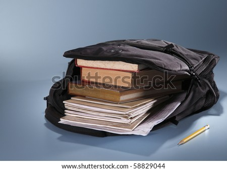 school bag fill up with book - stock photo