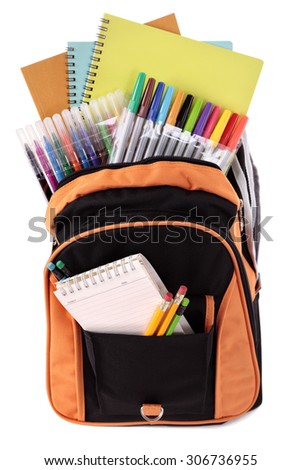 School bag full with student supplies, isolated - stock photo
