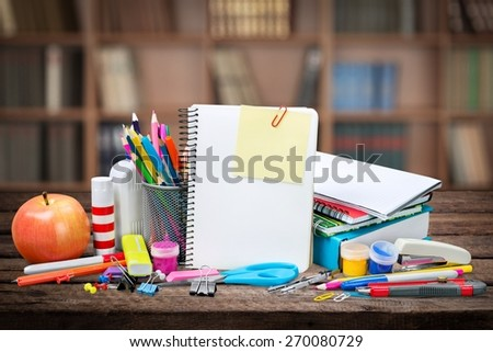 School. Blank notebook sheet and apple. Schoolchild and student studies accessories. Back to school concept. - stock photo