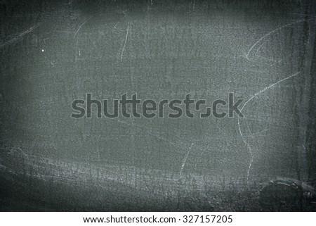 School board. Blank empty frame blackboard, with chalk traces. - stock photo