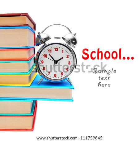 School... Books and an alarm clock. - stock photo