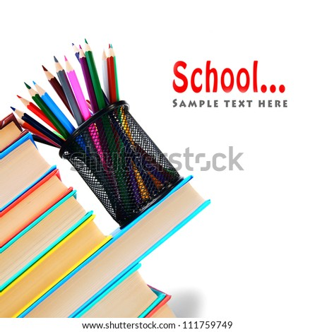 School... Books and pencils in a basket. - stock photo