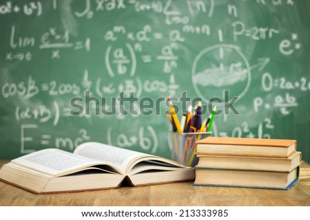 School books on desk, education concept - stock photo