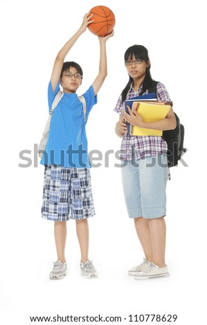 School boy and girl, with backpacks ,ball posing on white background - stock photo