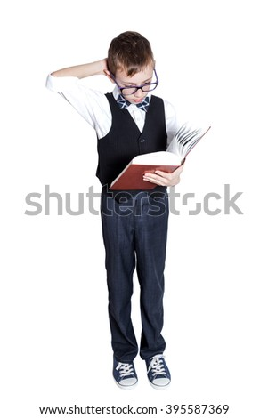 School boy is holding a book isolated on white background
