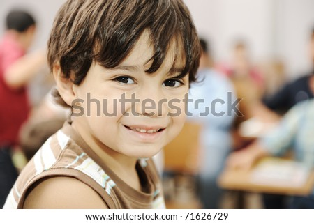 school boy is smiling - stock photo