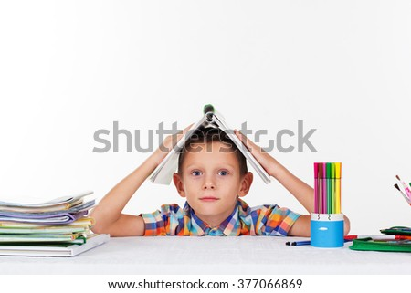 School boy is tired with lessions - stock photo
