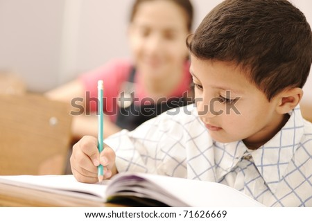 school boy is writing - stock photo