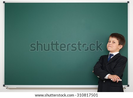 school boy on clear board background - stock photo