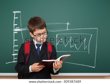 school boy read book about electricity - stock photo