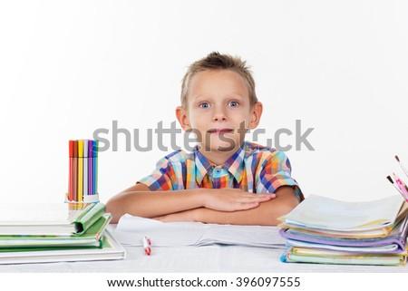 School boy thinking about homework - stock photo