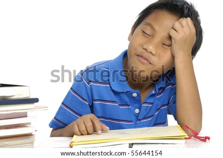 School boy tired of studying and sleeping with books on isolated background
