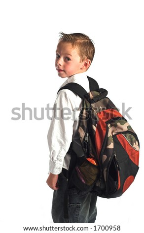 School boy wearing back pack against white background