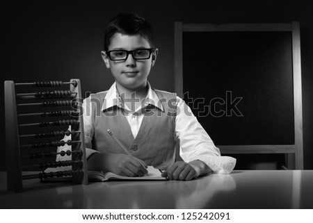 School boy with education tools - stock photo