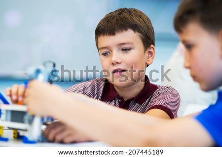School Boys playing with construction set. Educational games for kids. - stock photo