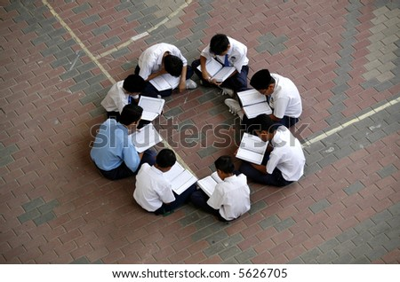 School boys studying in groups.