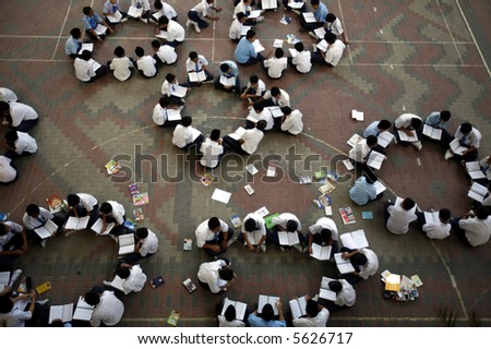 School boys studying in groups. - stock photo