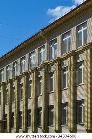 School building against summer landscape. Ufa city. - stock photo