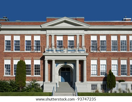 School building - North America historic brick school architecture - stock photo