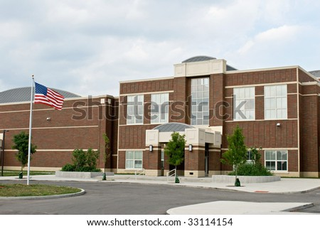 School Building with Flag - stock photo