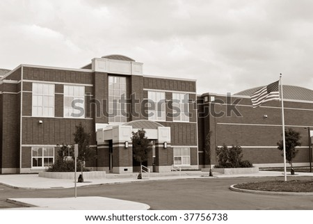 School Building with Flag in Sepia - stock photo